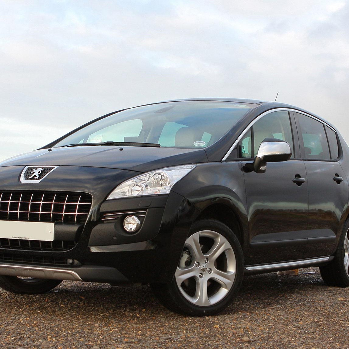 Peugeot 3008 for rent in Kefalonia black side front view parked by the sea